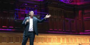 Steve Davis performing comedy at the Melbourne Town Hall
